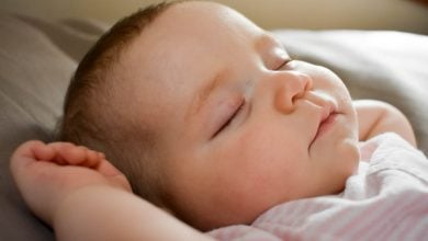 Oxytocin strengthens mothers' neural responses to infant and adult faces